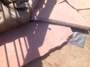 Chalking the cut line onto the flagstone.