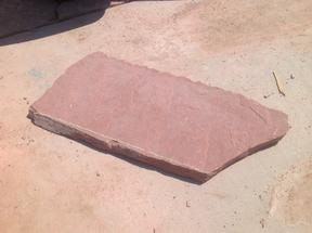 Straight cut line on a piece of flagstone.