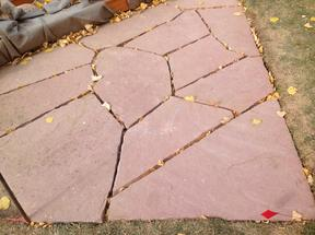 Flagstone patio before filling the cracks.