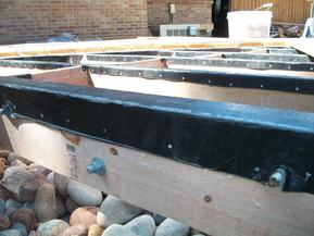 View of ice-and-water wrapping tops of joists